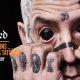 Artist Johnny Nobody arutleb oma näo ja silma tätoveeringute üle